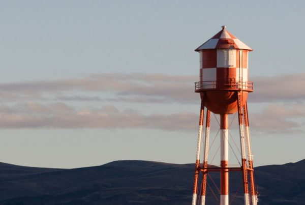 A red and white checkered water tower containing water resources for native american tribes
